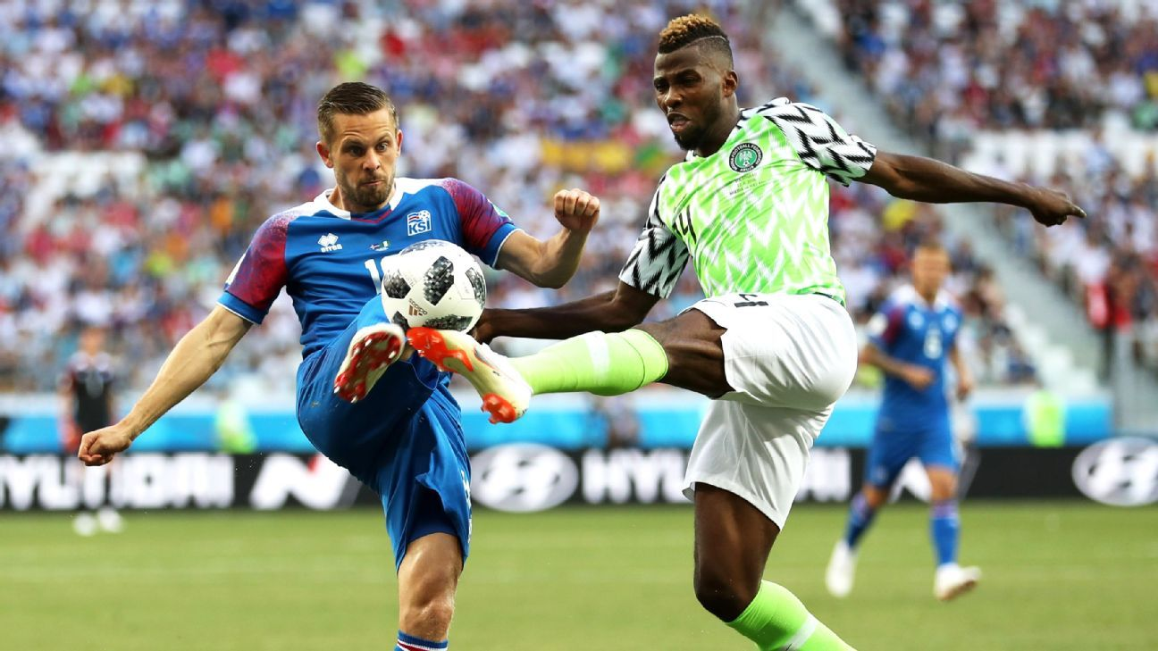 VOLGOGRAD, RUSSIA - JUNE 22:  Gylfi Sigurdsson of Iceland is tackled ny Kelechi Iheanacho of Nigeria  during the 2018 FIFA World Cup Russia group D match between Nigeria and Iceland at Volgograd Arena on June 22, 2018 in Volgograd, Russia.