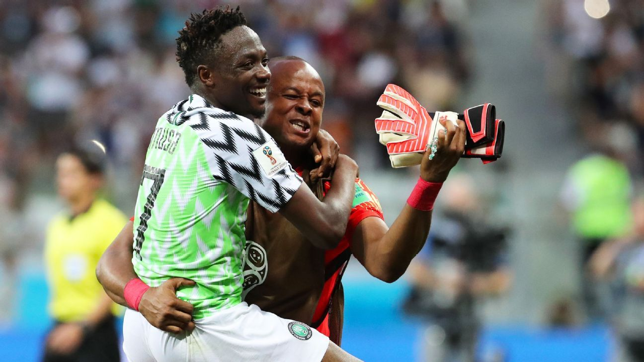 epa06831451 Ahmed Musa (L) and goalkeeper Ikechukwu Ezenwa of Nigeria celebrate after the FIFA World Cup 2018 group D preliminary round soccer match between Nigeria and Iceland in Volgograd, Russia, 22 June 2018. Nigeria won the match 2-0.