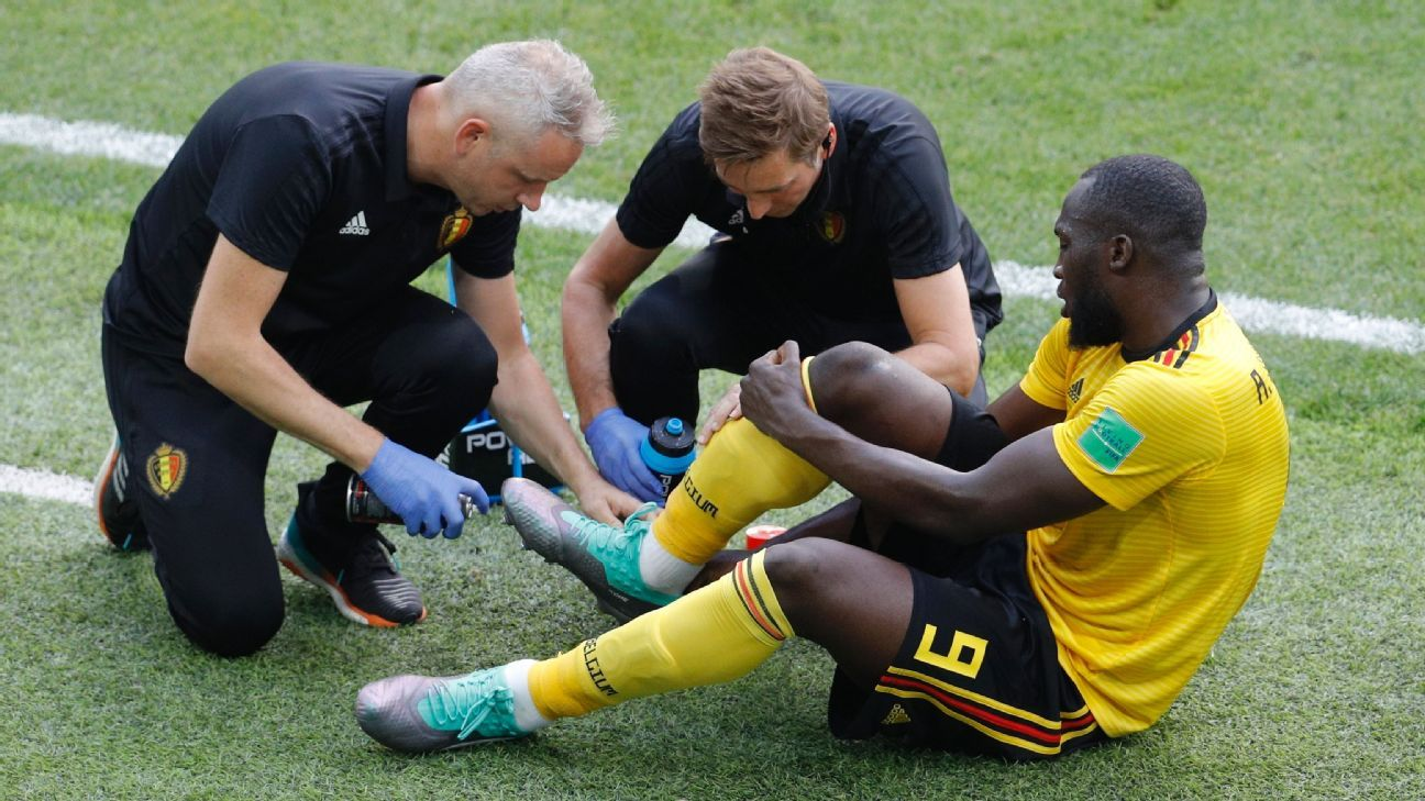 Romelu Lukaku gets treatment on an ankle injury against Tunisia.