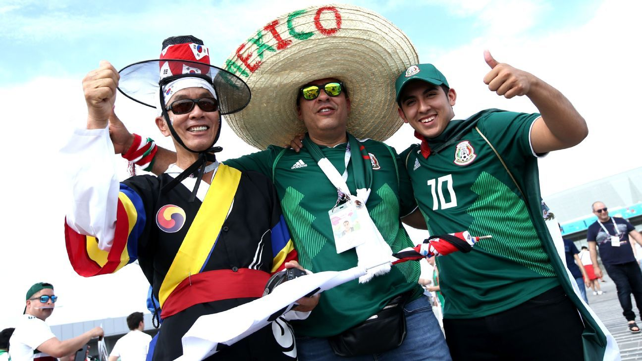 Mexico and South Korea fans enjoy the prematch atmosphere prior to their 2018 FIFA World Cup game.