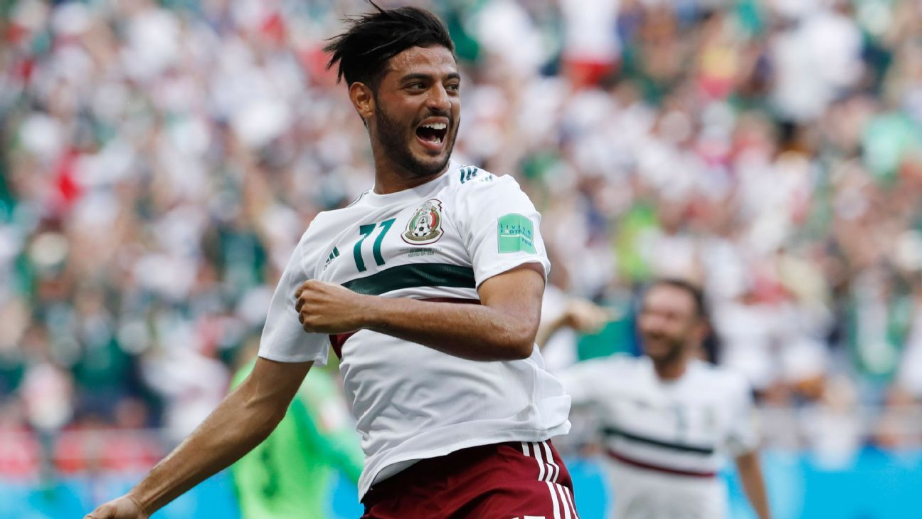 Carlos Vela of Mexico celebrates scoring his penalty.