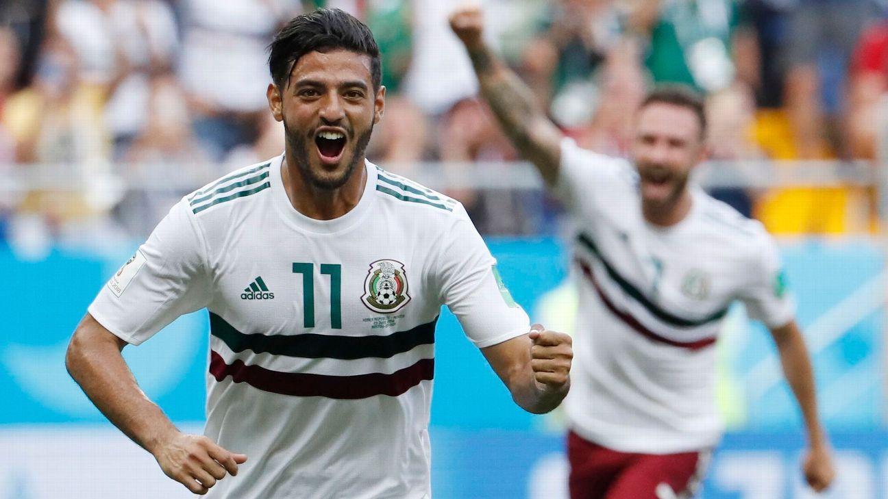 Carlos Vela of Mexico celebrates his penalty.