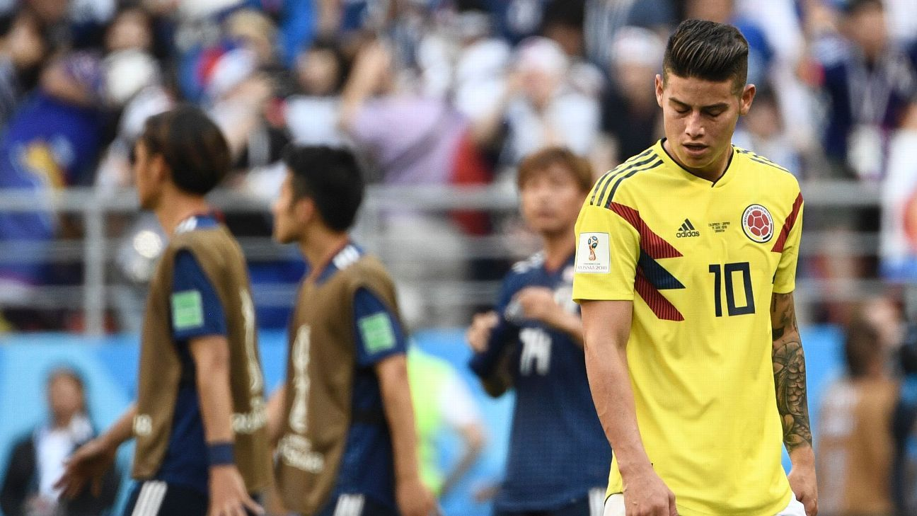 James Rodriguez looks on after Colombia were beaten by Japan in their World Cup group-stage match.