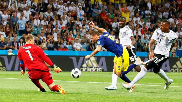 Marcus Berg goes down under pressure from Jerome Boateng.