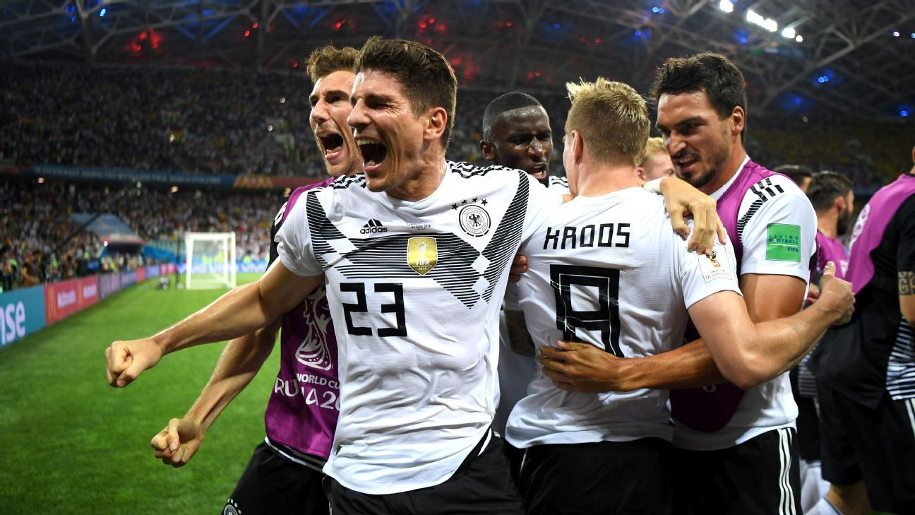 Germany players celebrate after their stoppage-time win over Sweden in the World Cup group stage.