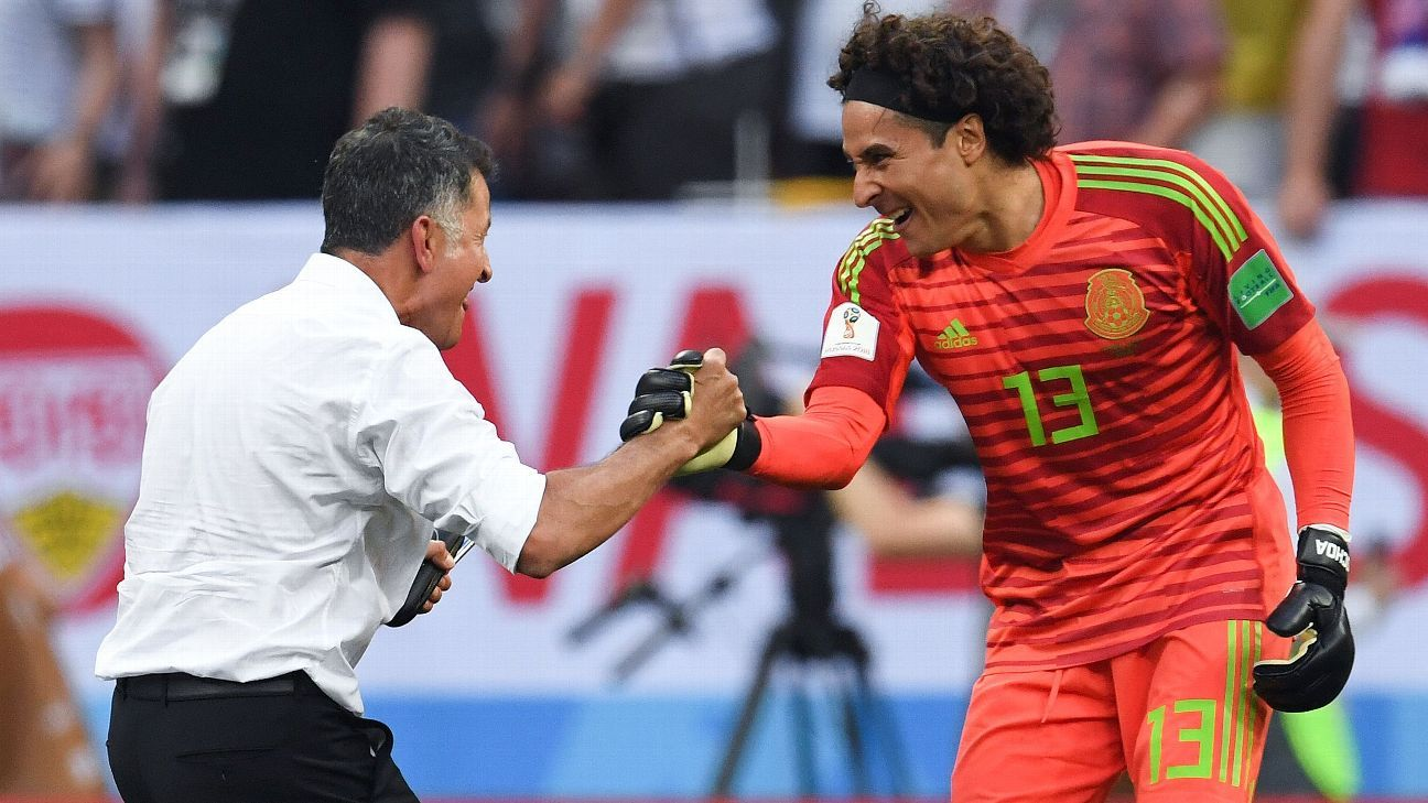 Mexico's Juan Carlos Osorio and Guillermo Ochoa celebrate their win over Germany