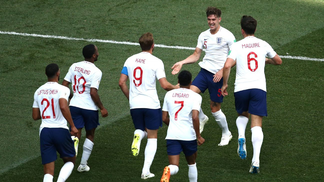 John Stones celebrates with his teammates after scoring England's fourth goal.