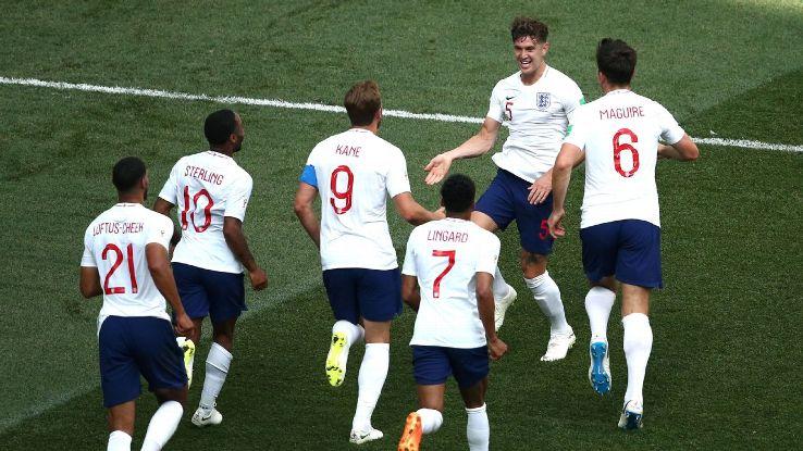 John Stones celebrates with his teammates after scoring England's fourth goal.