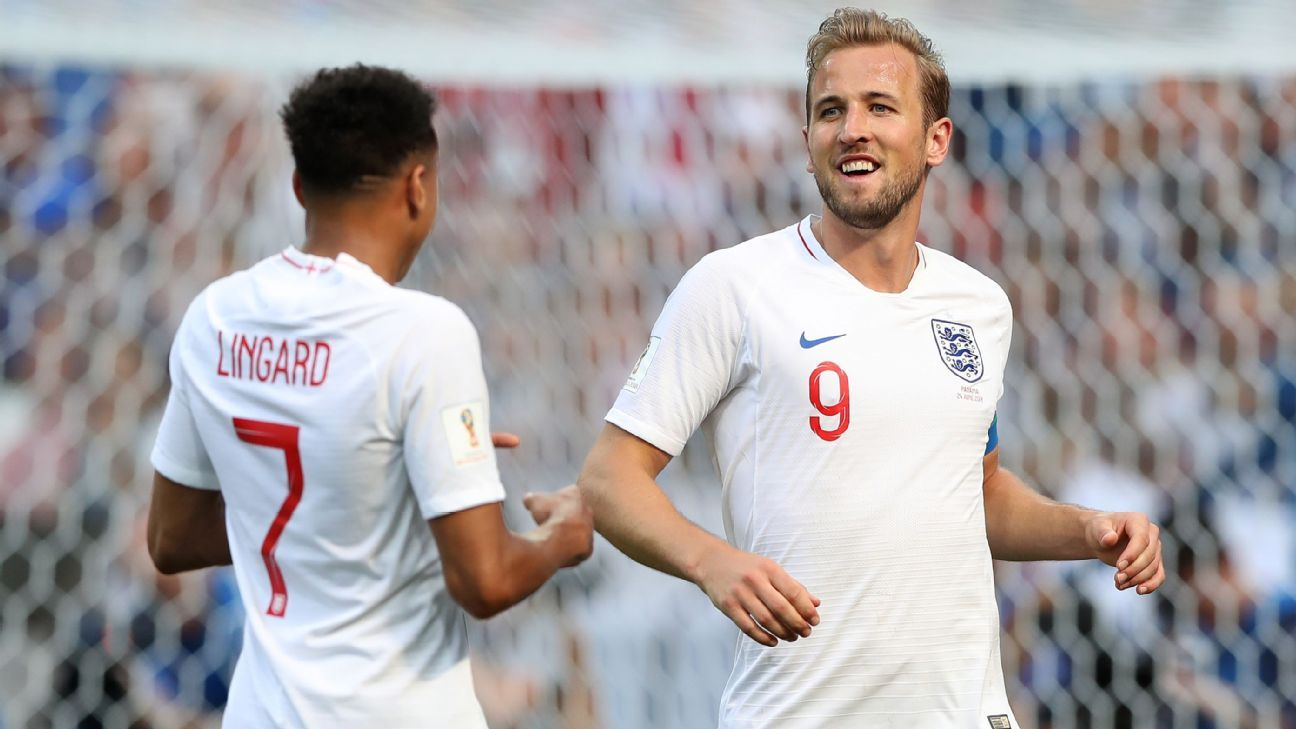 Harry Kane celebrates with teammate Jesse Lingard.