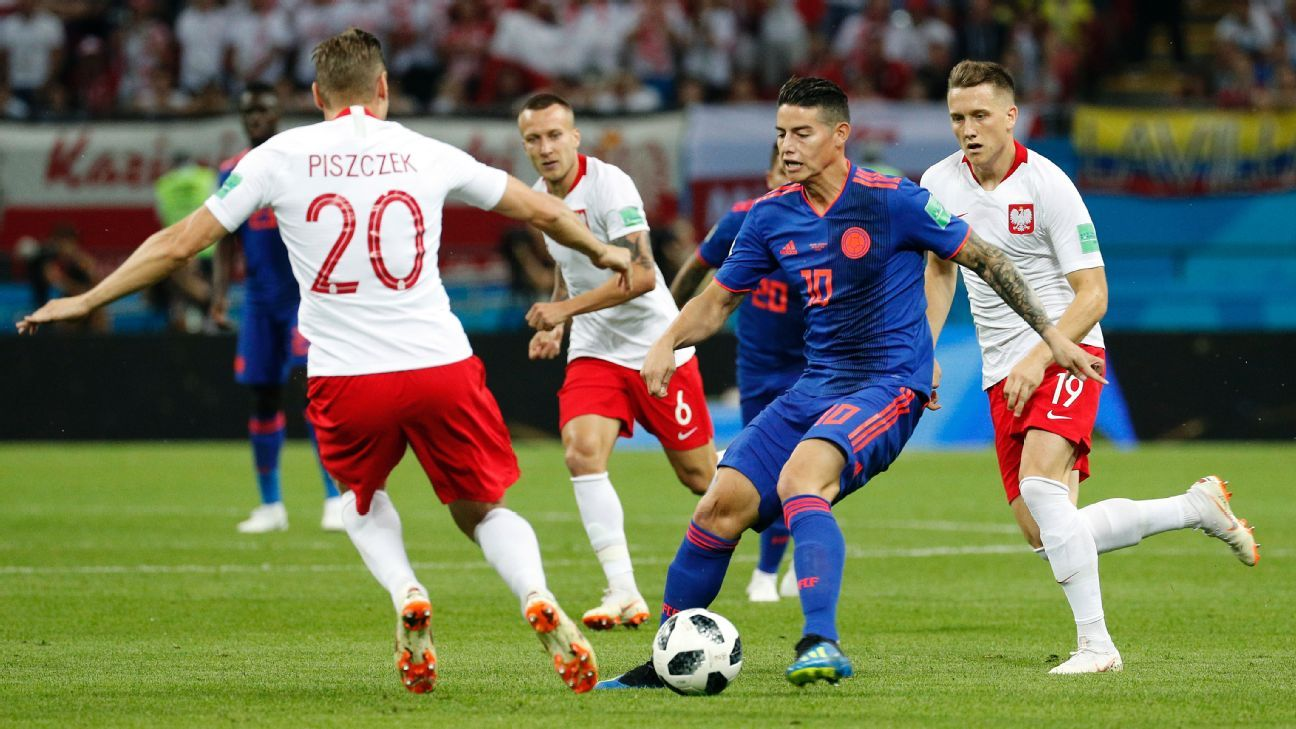 James Rodriguez and Lukasz Piszczek in action.