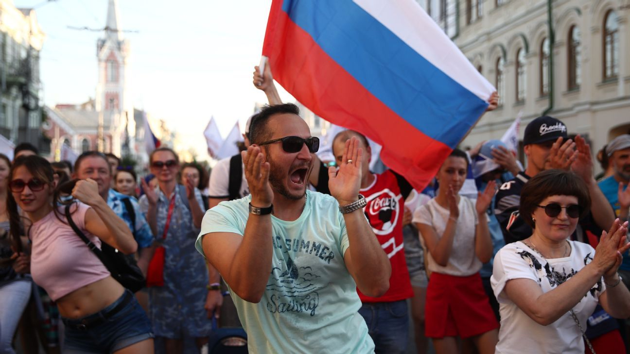 Football fans parade in the city centre to support the Russian national football team