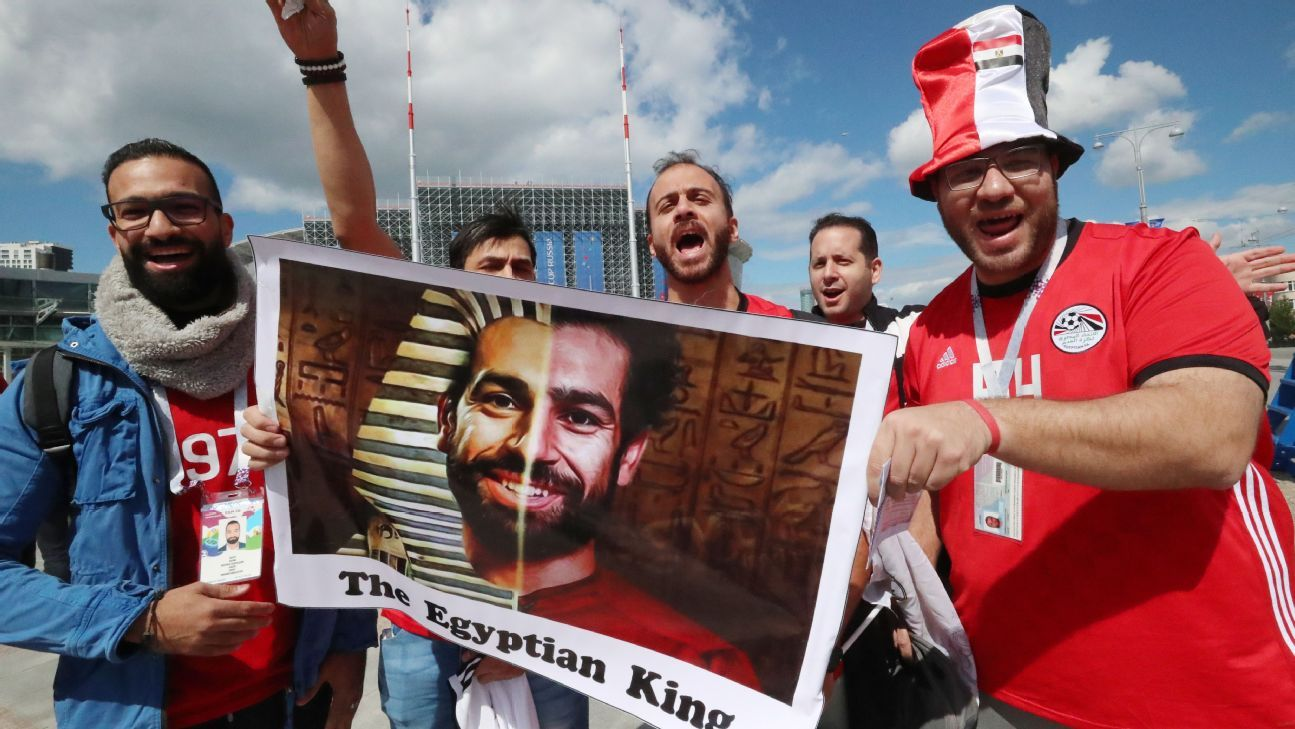 Egypt fans hold a picture of Mo Salah.