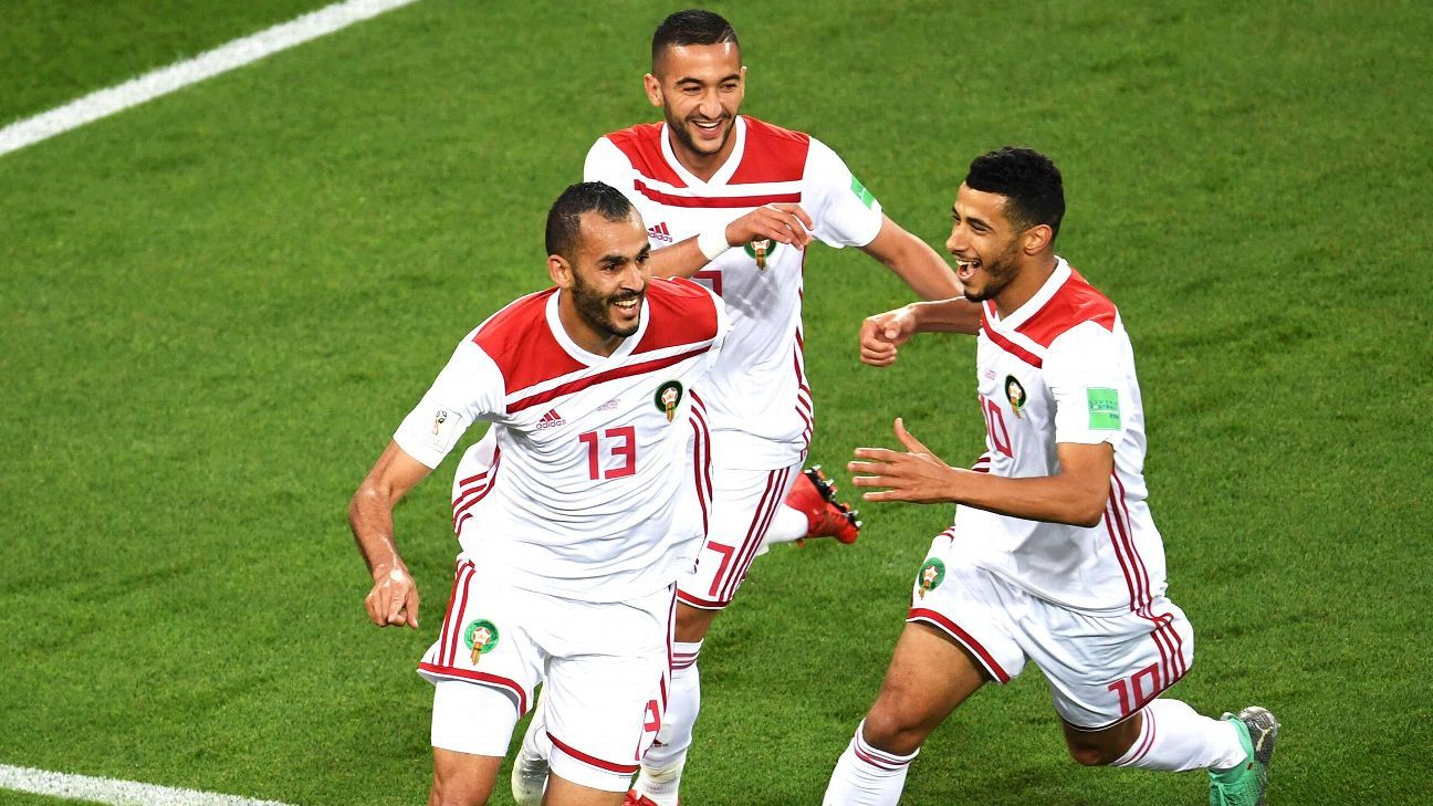 Morocco's forward Khalid Boutaib (L)  celebrates after scoring the opener during the Russia 2018 World Cup Group B football match between Spain and Morocco at the Kaliningrad Stadium in Kaliningrad on June 25, 2018.