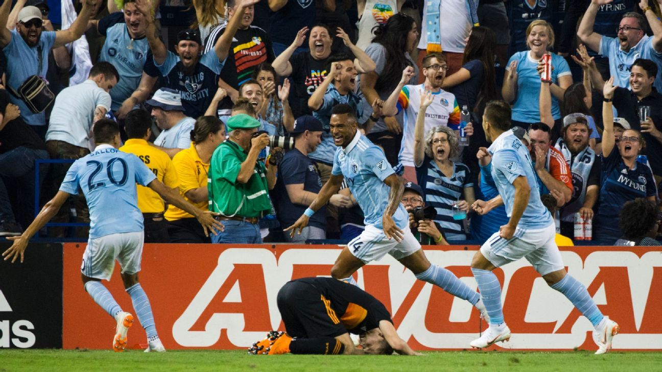 Khiry Shelton and SKC rallied from two-goals down to shock Houston 3-2.
