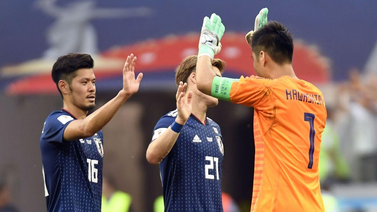 Japan's midfielder Hotaru Yamaguchi (L) and teammates celebrate their qualification