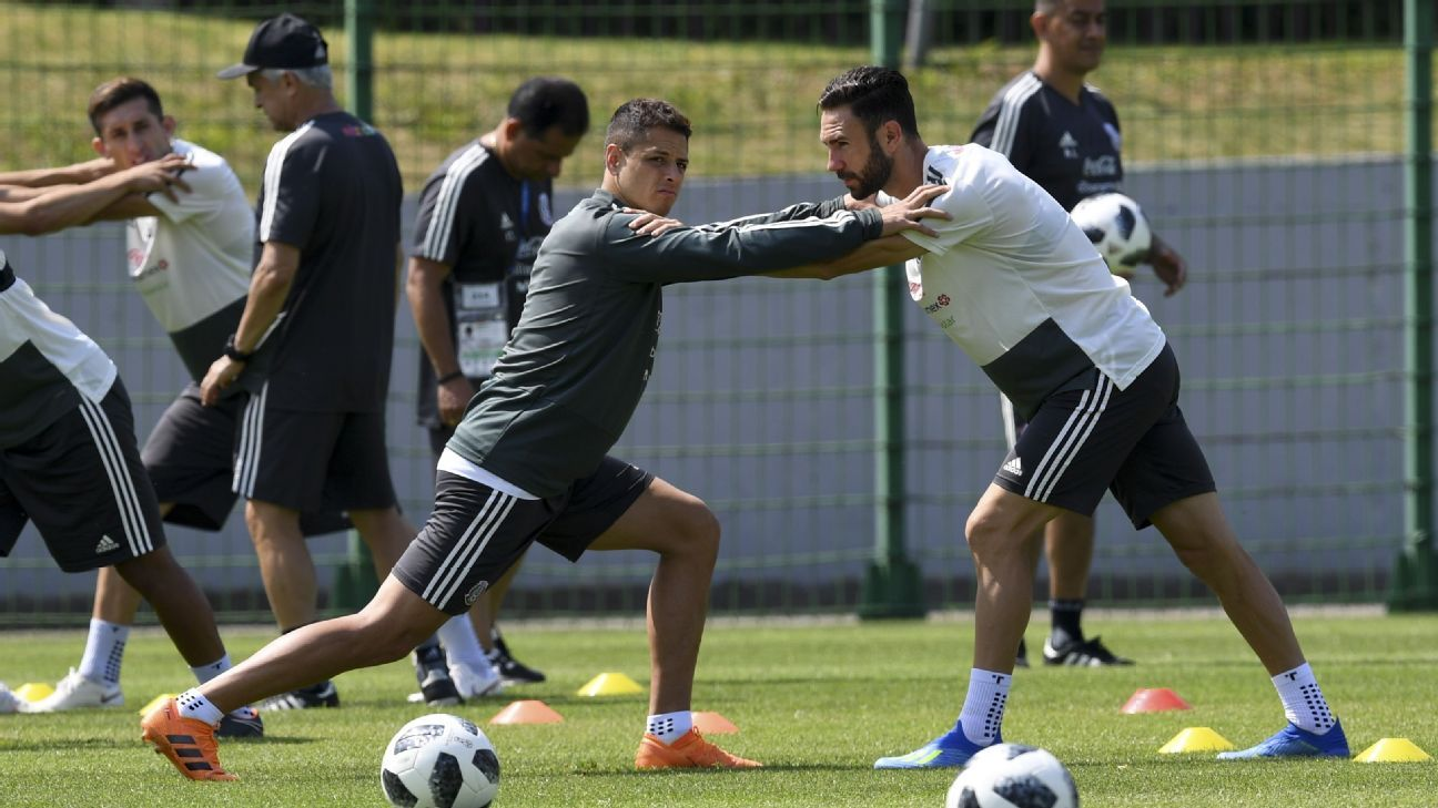 Mexico's Javier Hernandez, left, and Miguel Layun train ahead of their World Cup match with Brazil on Monday.