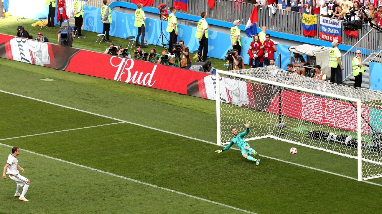 Artem Dzyuba of Russia scores a penalty past David De Gea of Spain.