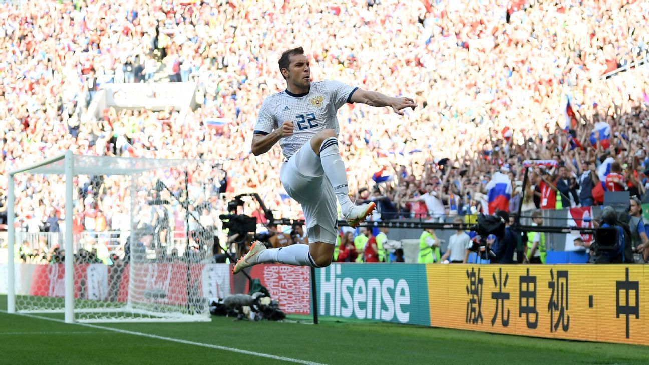 Artem Dzyuba of Russia celebrates after scoring his team's first goal.