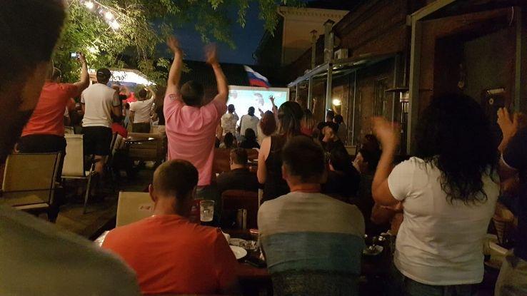 Fans celebrate Russia's first goal.