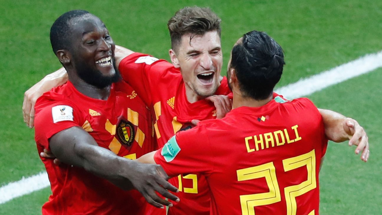 Thomas Meunier (c) celebrates with teammates after creating Belgium's late winner vs. Japan.