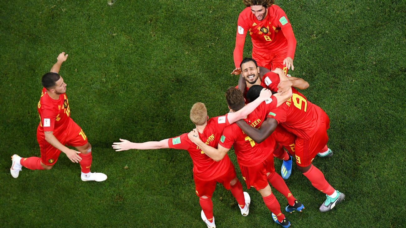 Belgium celebrate after Nacer Chadli's stoppage-time goal earned the Red Devils a win over Japan.