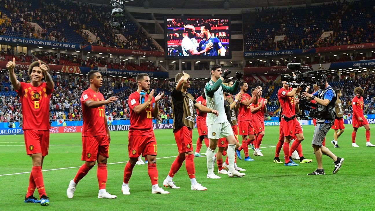 Belgium players salute their supporters after a World Cup round-of-16 win against Japan.