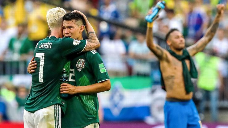 Miguel Layun and Hirving Lozano embrace after Mexico's round-of-16 defeat to Brazil.