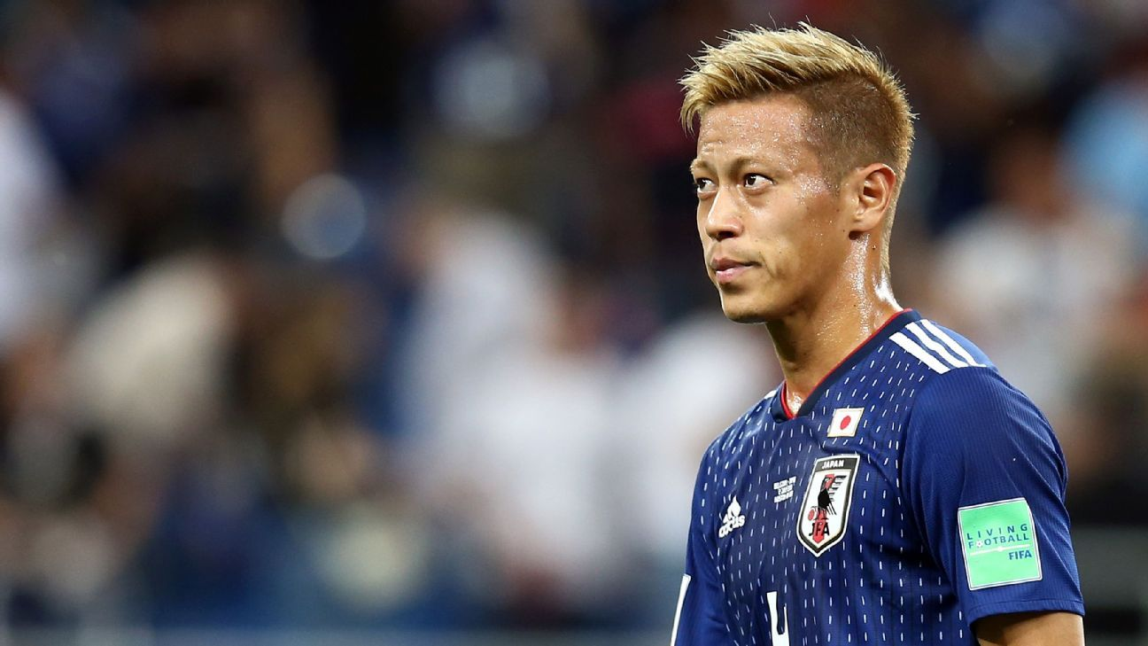 Keisuke Honda looks on in despair as Japan are knocked out of the World Cup.
