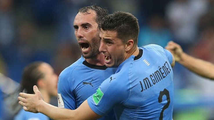 Diego Godin and Jose Maria Gimenez celebrate after Uruguay's round-of-16 win over Portugal.
