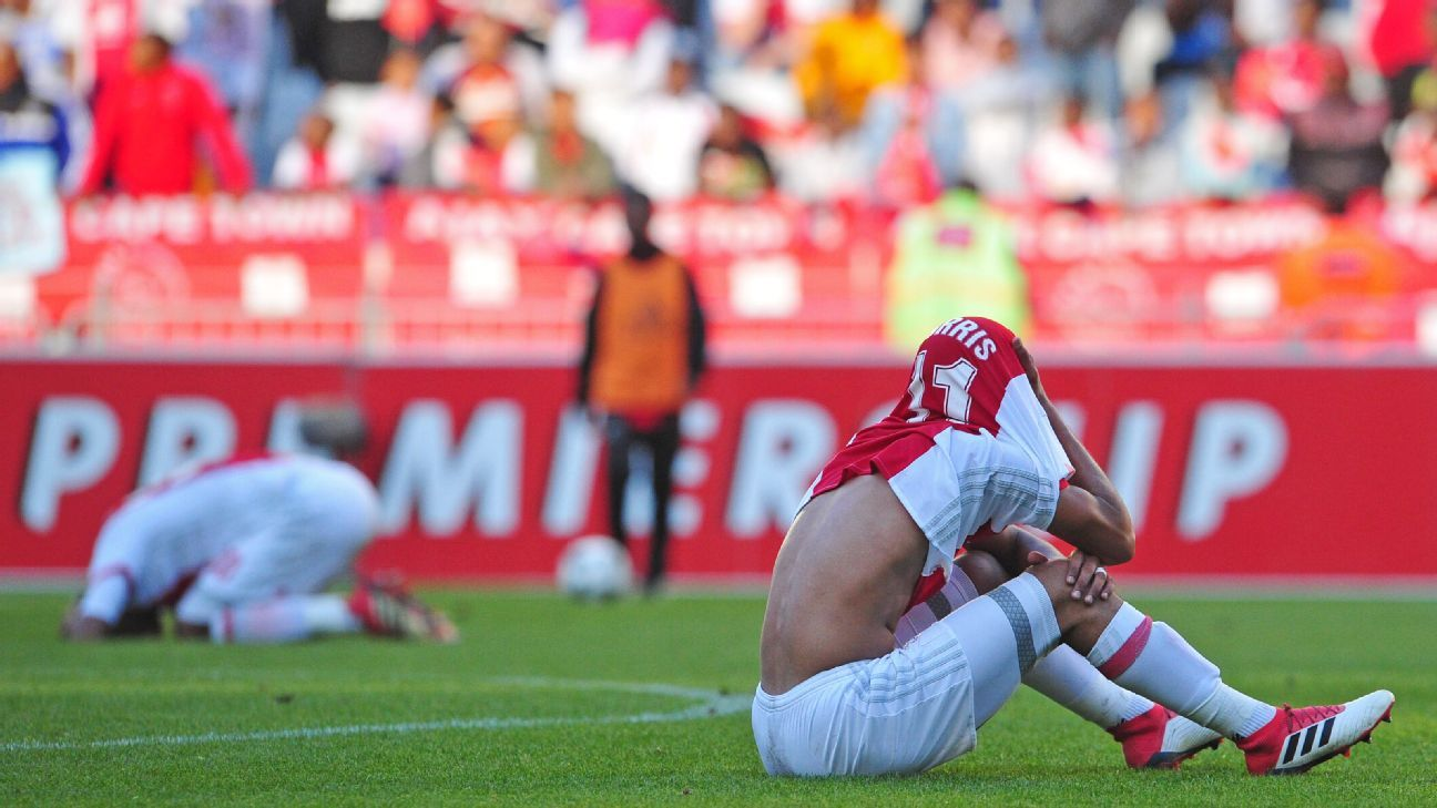 Tashreeq Morris of Ajax Cape Town sits dejected after the club was relegated