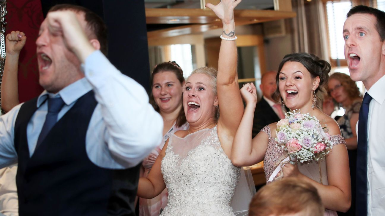 Three Lion supporters Nadine and Lee Hanlon were not going to miss England-Sweden even on their wedding day.
