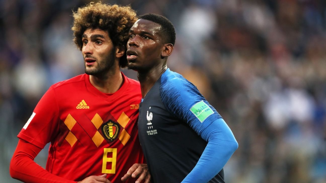 SAINT PETERSBURG, RUSSIA - JULY 10: Manchester United teammates Marouane Fellaini of Belgium and Paul Pogba of France during the 2018 FIFA World Cup Russia Semi Final match between Belgium and France at Saint Petersburg Stadium on July 10, 2018 in Saint P