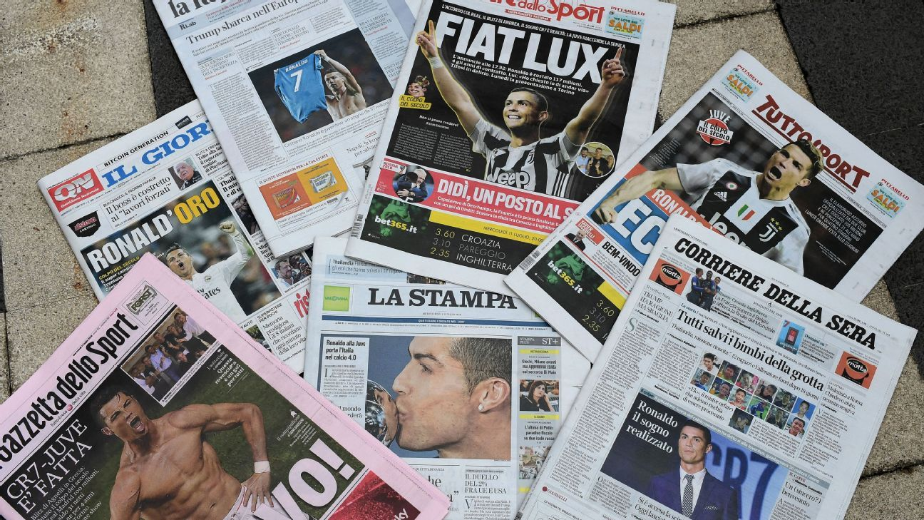 A picture taken on July 11, 2018 in Milan shows the Italian newspapers front pages.