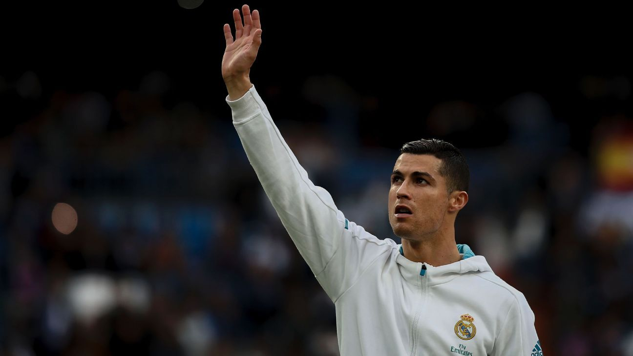 Cristiano Ronaldo waves to the Real Madrid faithful at the Santiago Bernabeu.