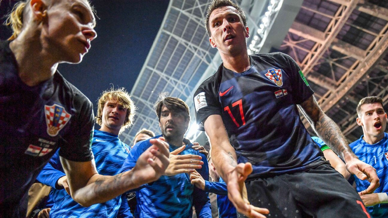 World Cup photographer receives gift from Croatia's Mario Mandzukic