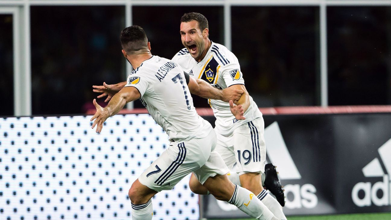LA Galaxy stun New England Revolution with two stoppage-time goals