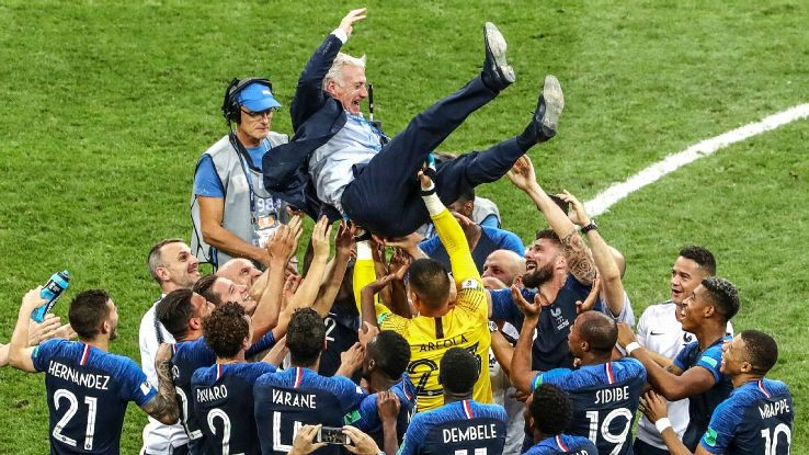 France players celebrate with manager Didier Deschamps after winning the World Cup.