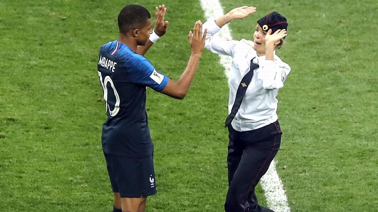 France forward Kylian Mbappe gave one of the protesters a greeting before security stepped in.