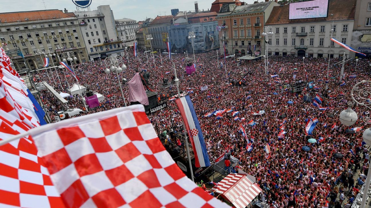 Fans wave flags and celebrate in the Bana Jelacica Square in Zagreb, Croatia.