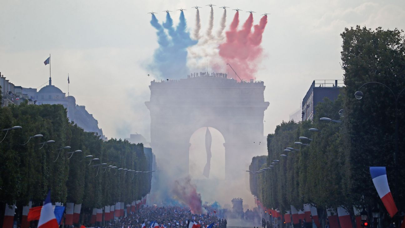 Jets flew over the Arc de Triomphe as fans packed the Champs Elysee.