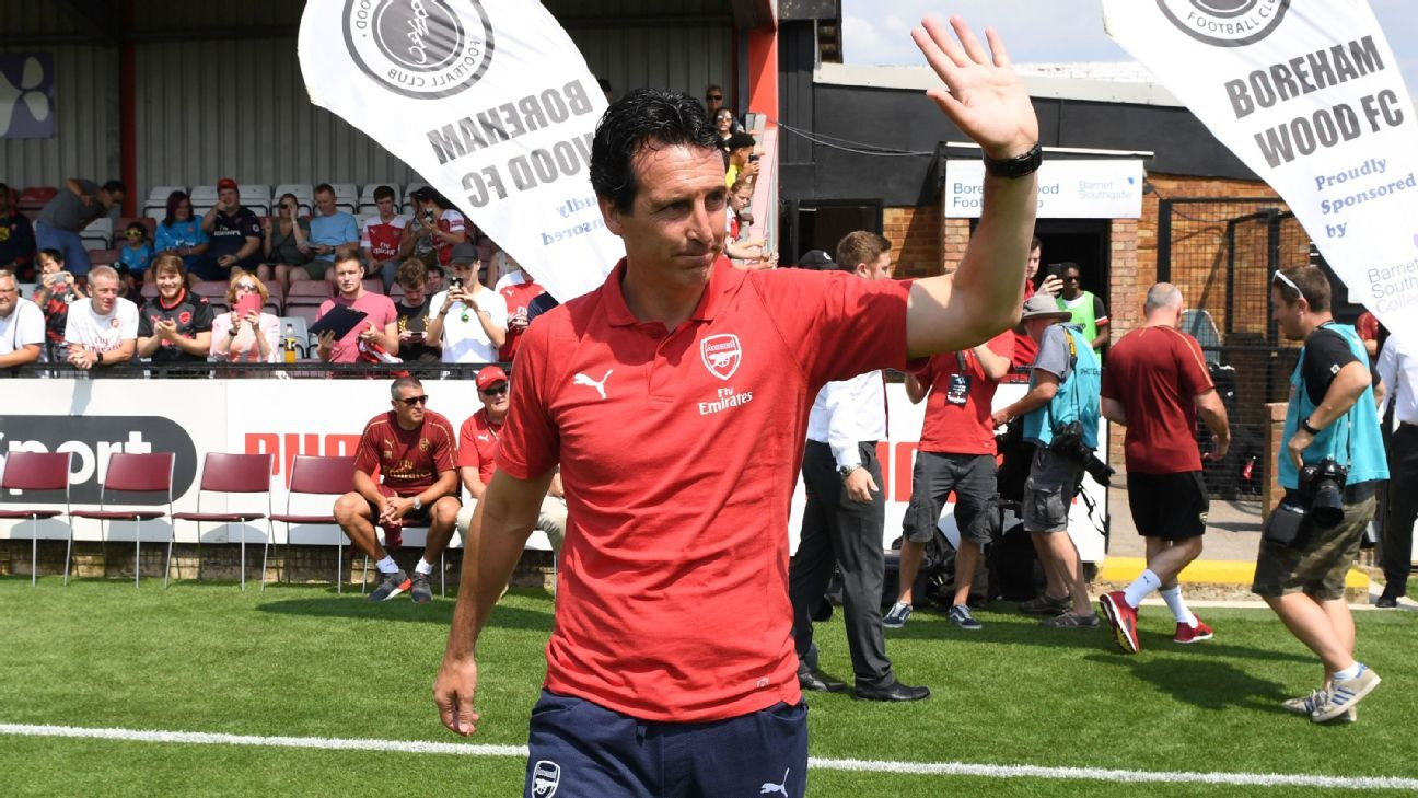 Unai Emery waves to fans before Arsenal's preseason friendly at Boreham Wood.