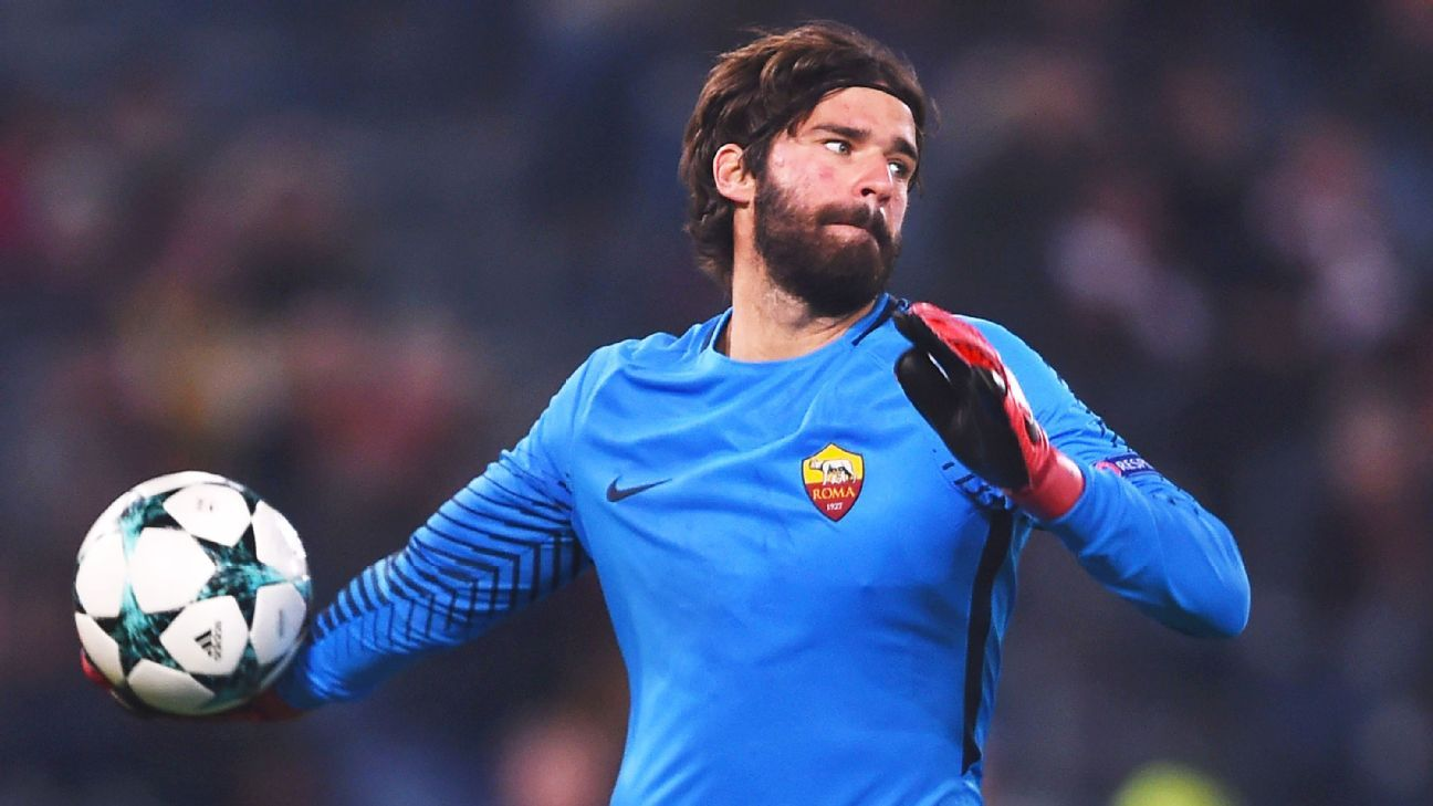 Roma's Brazilian goalkeeper Alisson throws the ball during the UEFA Champions League Group C football match AS Roma vs FK Qarabag on December 5, 2017 at the Olympic stadium in Rome.  / AFP PHOTO / Filippo MONTEFORTEFILIPPO MONTEFORTE/AFP/Getty Images