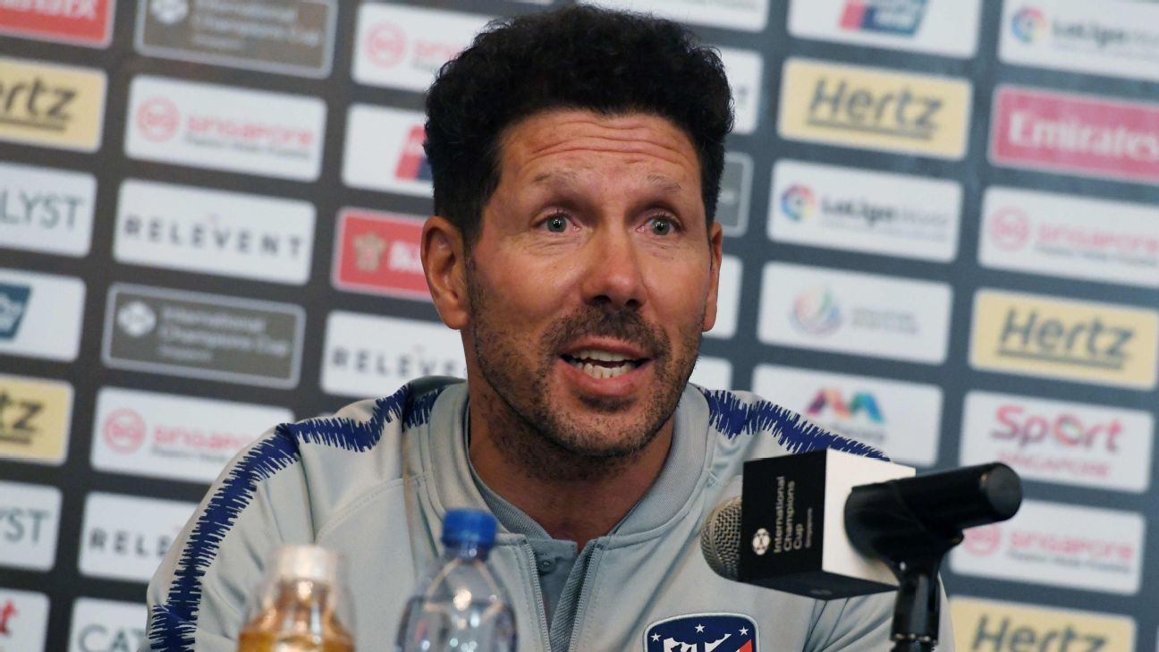 Diego Simeone speaks at a news conference.