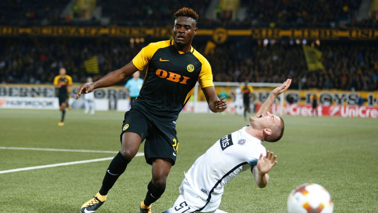 YB's Kasim Nuhu in action against Belgrade's Ognjen Ozegovic during the UEFA Europa League.
