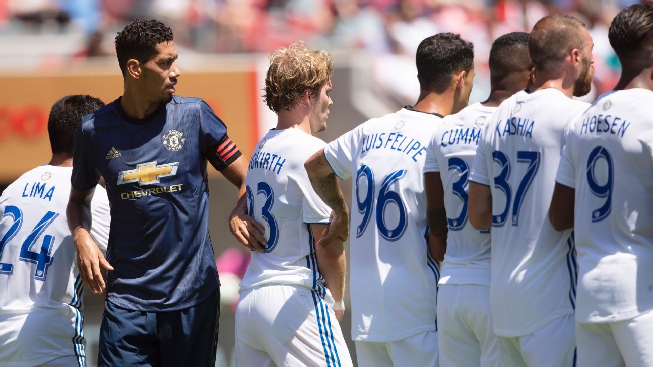 Chris Smalling stands among opponents in Manchester Uniter's friendly clash with the San Jose Earthquakes.
