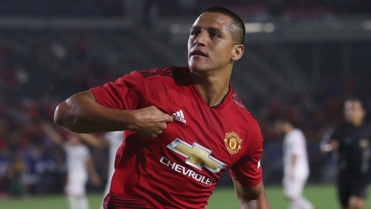 Alexis Sanchez celebrates scoring in Manchester United's International Champions Cup win over AC Milan.