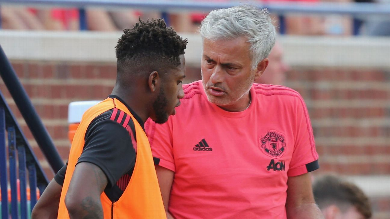 Jose Mourinho talks with Fred during Manchester United's International Champions Cup loss to Liverpool.