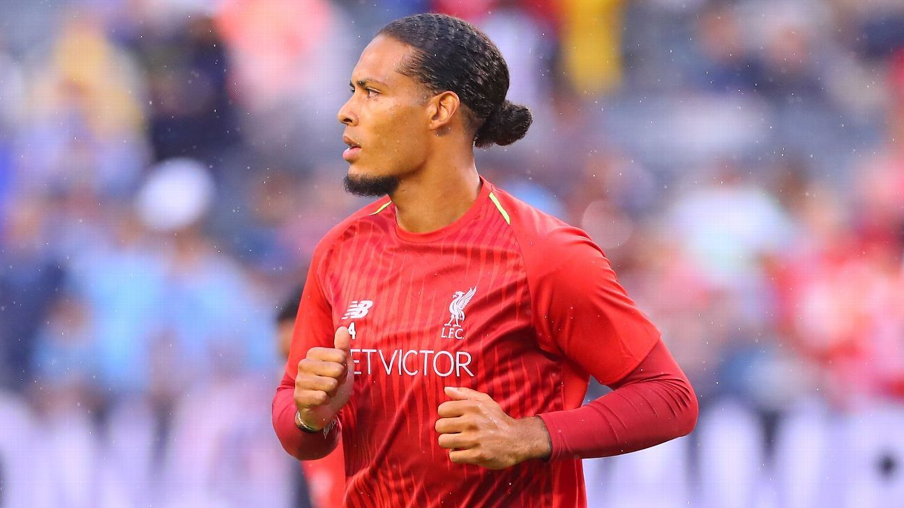 Liverpool's Virgil van Dijk warms up before a friendly.
