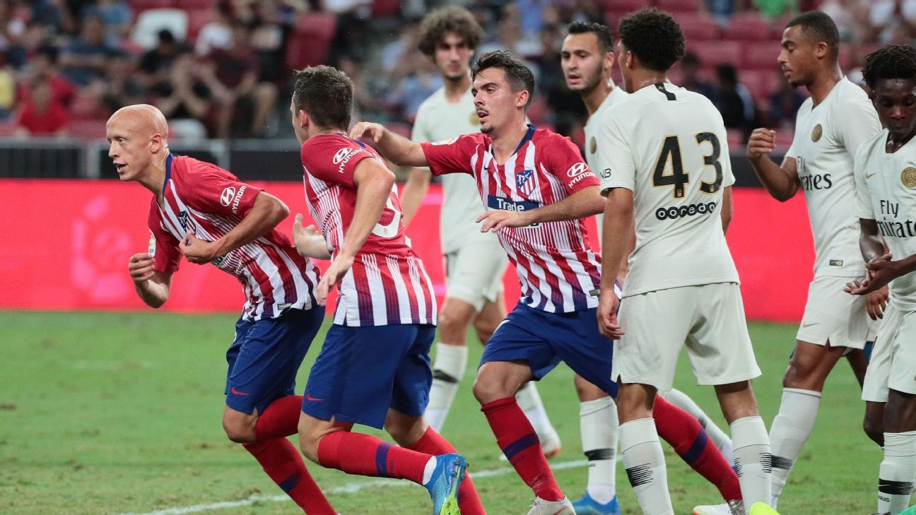 Victor Mollejo, left, celebrates his goal for Atletico Madrid.
