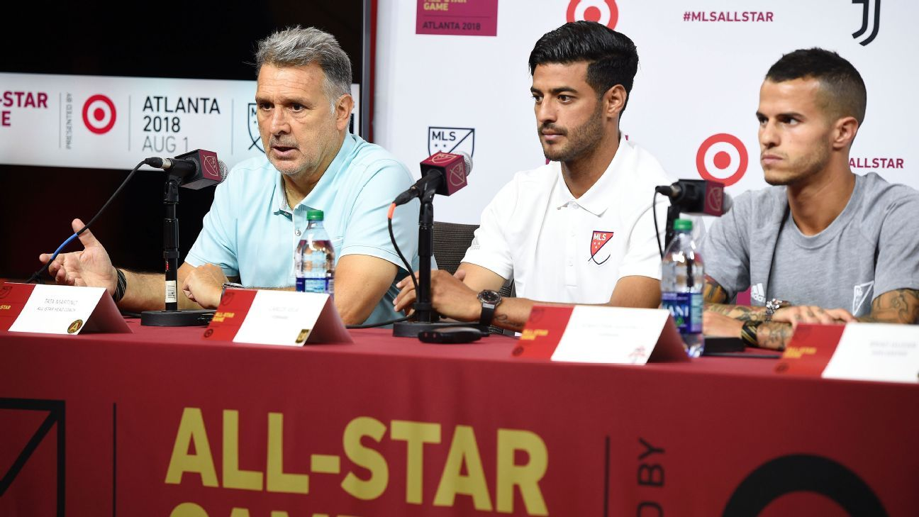 Tata Martino, left, at a press conference ahead of the 2018 MLS-All-Star Game.